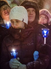 Tara and Keith Kohler of Northville attended the vigil, remembering Tara's sister, Tracey.