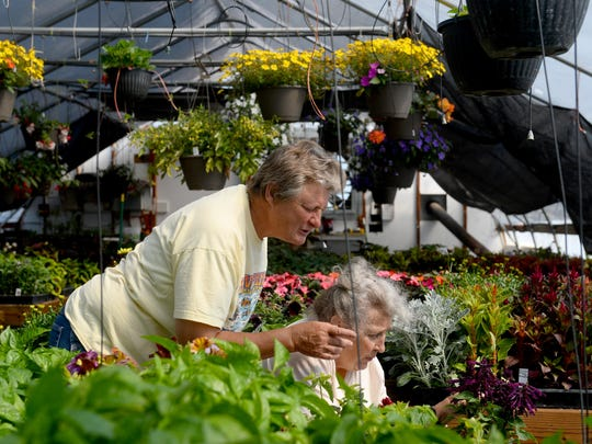 Jennie Graham, owner of Jennie's Greenhouse, with her