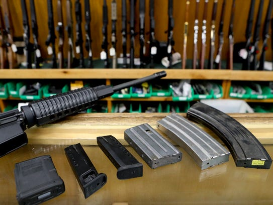 Four groups have sued the state over new rules regulating assault weapons.