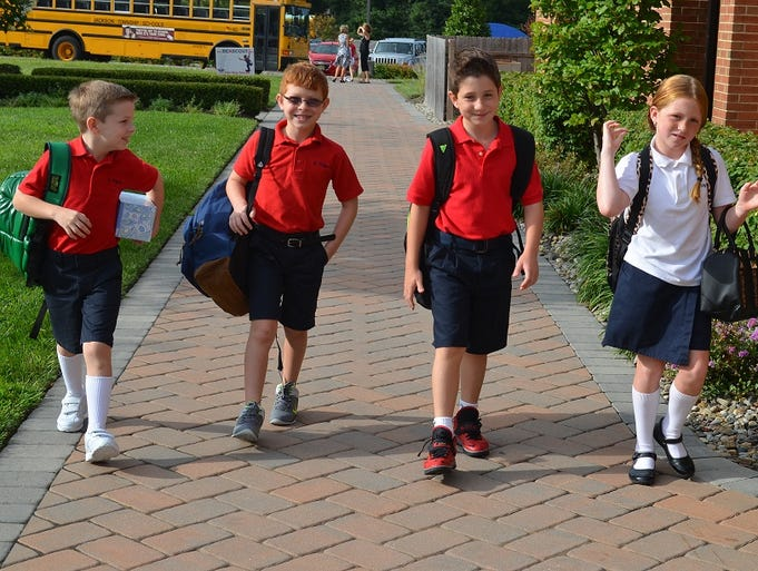 Students are coming back for their first day of the 2014/2015 school year.  This year marks the 20th Anniversary of St. Aloysius School.