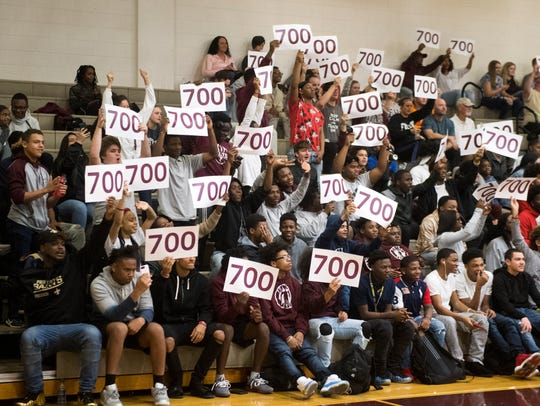 Fulton's fans reveal in unison signs signifying Coach