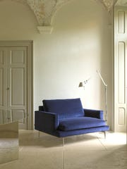 Versatile and romantic, indigo blue shows off furniture frames well. This Verzelloni armchair reflects '60s modern style.
