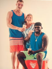 Diane Walters, center, poses with son, Rob Gronkowski and David Ortiz during a break in a Dunkin' Donuts ad campaign.