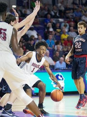 Pebblebrook High School's Collin Sexton eludes Brentwood Academy players during play Saturday at the Culligan City of Palms Classic at the Suncoast Credit Union Arena in Fort Myers.