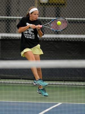 Abilene High's Lauren Schaeffer returns a ball during her match with partner Rachel Tebow in the girls doubles championship match of the 2017 Abilene Eagle Invitational tennis tournament on Saturday, April 1, 2017, at Abilene High School.