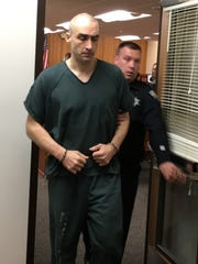 David Kalac, sentenced Tuesday to 82 years in prison, is led out of Kitsap County Superior Court.
