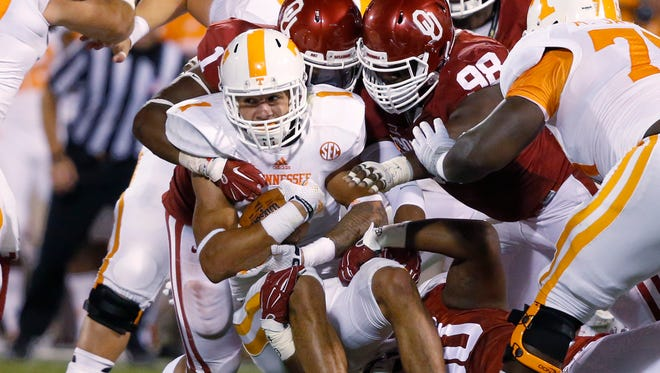Tennessee coach Butch Jones wants players such as running back Jalen Hurd (1) motivated by last week's loss to No. 4 Oklahoma.