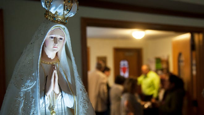 The International Pilgrim Virgin Statue of Our Lady of Fatima stands in the back of St. Joan of Arc Church in Camden prior to a procession in the church on Friday. 05.01.15