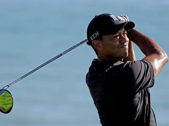 Tiger Woods hits a drive on the 17th hole during a practice round for the PGA Championship on Aug. 12, 2015,