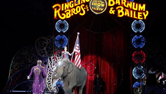 An Asian elephant performs during the national anthem for the final elephant performance during the Ringling Bros. and Barnum & Bailey Circus on May 1, 2016, in Providence, R.I.