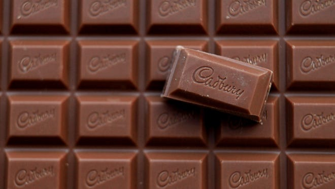 In this photograph, a bar of Cadbury's Dairy Milk chocolate is seen on January 19, 2010 in Bristol, England.
