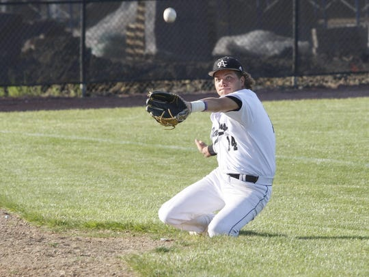 Ankeny leftfielder Alex Kopriva tries to catch a pop fly in foul territory during the first game of Wednesday's doubleheader against visiting Ankeny. Kopriva was unable to make the catch, but the Jaguars went on to sweep the twinbill by scores of 8-1 and 6-1.