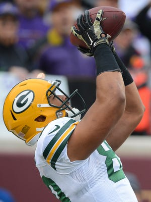 Green Bay Packers tight end Richard Rodgers (89) makes a touchdown catch all alone in the corner of the end zone against the Minnesota Vikings at TCF Bank Stadium November 23, 2014.