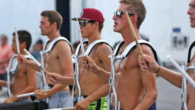 Andrew Manzanares, right, snare drum player with the Blue Devils, rehearses with other drummers for the Drum Corps International competition, Thursday, August 11, 2016.  They rehearsed at the Colts complex.