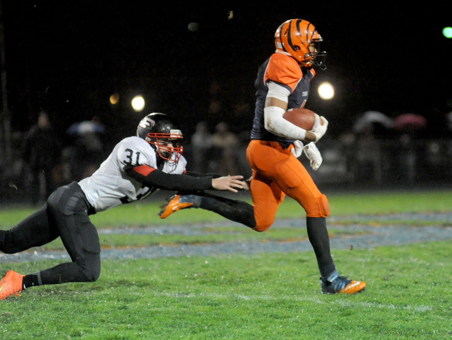 Galion Tigers kick returner Cario Davison outruns the Pleasant Spartans kickoff team enroute to a touchdown during first-half action in high school football Friday night, Oct. 31, 2014 at Galion.