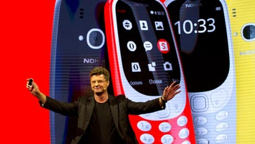Arto Nummela, Chief Executive Officer at HMD Global, shows the new re-launched Nokia 3310 phone.