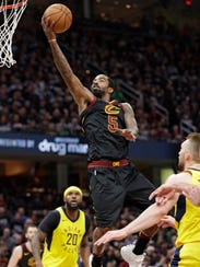Cleveland Cavaliers' JR Smith (5) drives to the basket