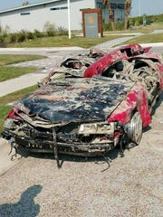 After it was removed from the beach, a red Honda Prelude
