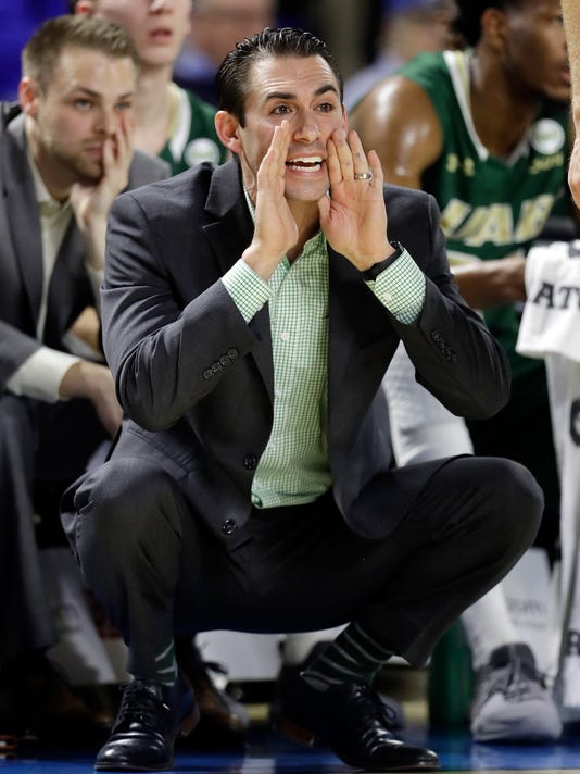 UAB coach Robert Ehsan yells to his players during the first half of an NCAA college basketball game against Middle Tennessee on Saturday, Feb. 24, 2018, in Murfreesboro, Tenn. (AP Photo/Mark Humphrey)