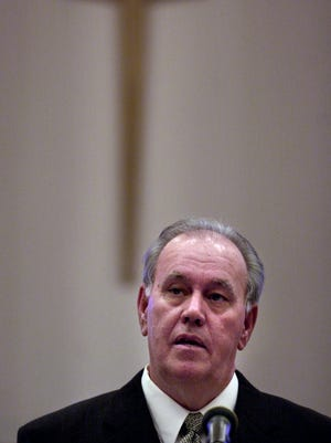 Phil Burress, president of Citizens for Community Values, speaks to a group of people at Lakeside Christian Church in Northern Kentucky in 2002.