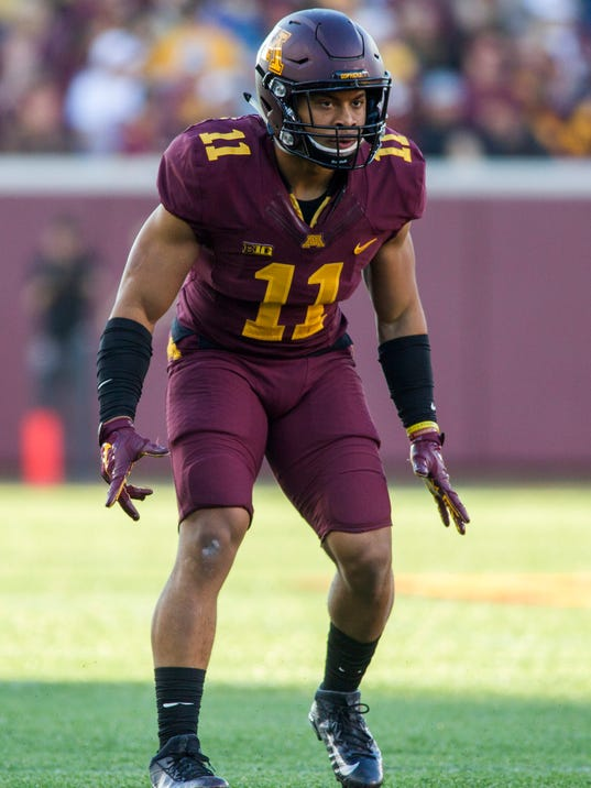 In this Saturday, Nov. 5, 2016, photo, Minnesota defensive back Antoine Winfield Jr. (11) plays during an NCAA college football game against Purdue, in Minneapolis. Winfield and two other players were cleared of sexual harassment allegations in the final round of appeals at the school and will be allowed to return to spring practice, while two more had their suspensions in connection with allegations of a sexual assault upheld. Provost Karen Hanson heard the appeals and upheld the decision to remove one-year suspensions for Winfield, running back Kobe McCrary and quarterback Mark Williams, attorney Ryan Pacyga said Monday, March 20, 2017. (AP Photo/Paul Battaglia)