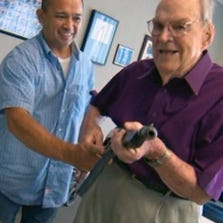A.J. Hilliard, 91, gets a look at his 1928-vintage Thompson A-1 submachine gun that he hadn't seen in seven decades.