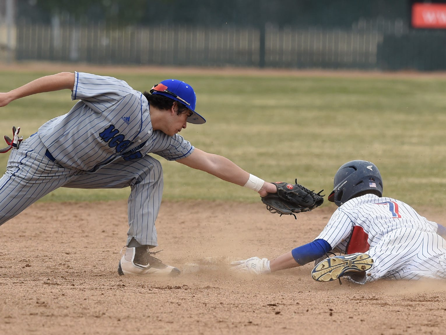 McQueen's Austin Parry reaches out to tag Reno Christian Chamberlain as he steals second base in the 2017 Mike Bearman Memorial on Friday March 10, 2017.