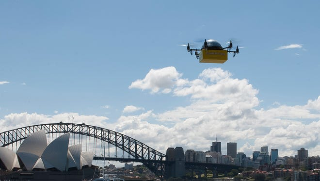 A Flirtey drone takes to the air with the Sydney, Australia, skyline in the background. Flirtey has conducted successful fully automated drone textbook-delivery tests in Sydney.