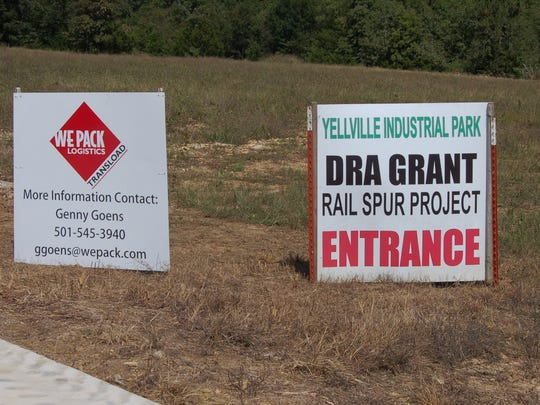 Signs mark the entrance of the drive leading to the