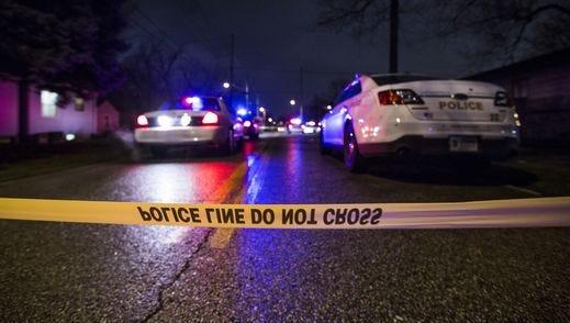 Police tape a crime scene.