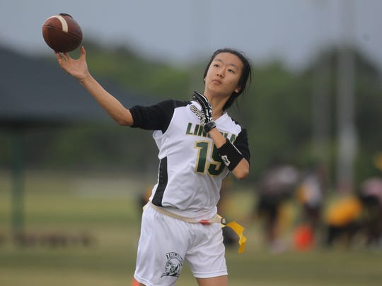 Lincoln quarterback Ivy Zheng throws a pass during the 2018 Capital City Classic.