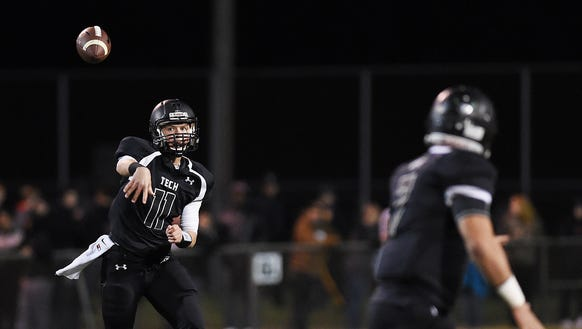 Sussex Tech senior quarterback Justin Hill throws to