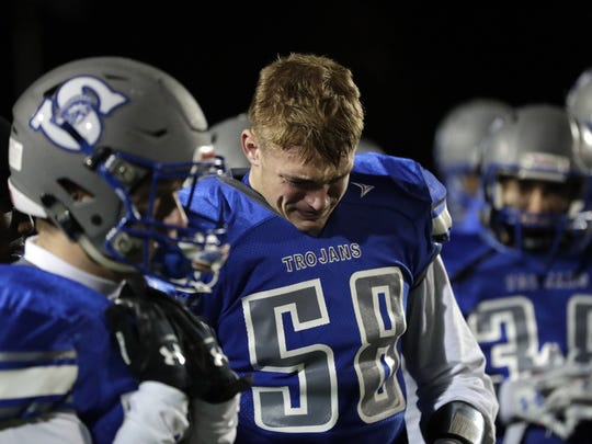 Green Bay Southwest's Cameran Crawford (58) leaves the field in tears after a 35-14 loss against Waunakee in a  WIAA Division 2 state semifinal football game Friday at Calder Stadium in Menasha.