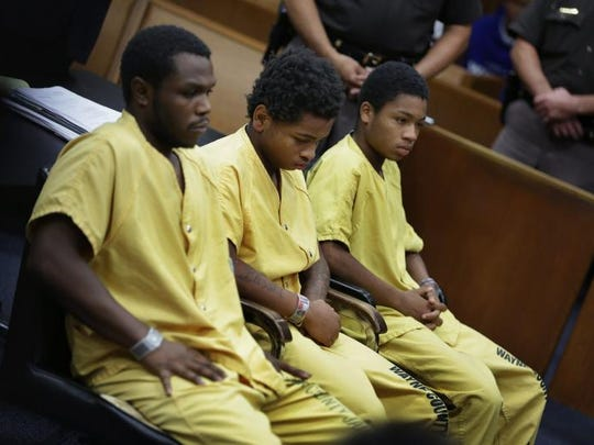 Drequone Rich, 20, from left, Jasin Curtis, 18, and Dionte Travis, 17, are charged in 36th District Court with felony murder, armed robbery, being a felon in possession of a firearm and using a firearm in a felony in connection with Bilal Berreni's death in July 2013.