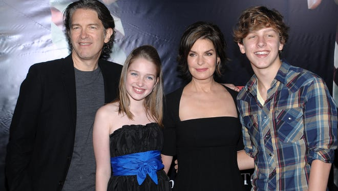 From left, Howard Sherman, Annabella Sherman, Sela Ward and Austin Sherman attend the premiere of 'The Stepfather' at the School of Visual Arts Theater on Monday, Oct. 12, 2009 in New York.