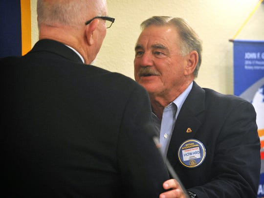 Howard Farrell, right, is congratulated by fellow Rotarian Bob Brotherton after Farrell was named Rotary Club of Wichita Falls Outstanding Citizen of the Year during the club's meeting Thursday at Luby's.