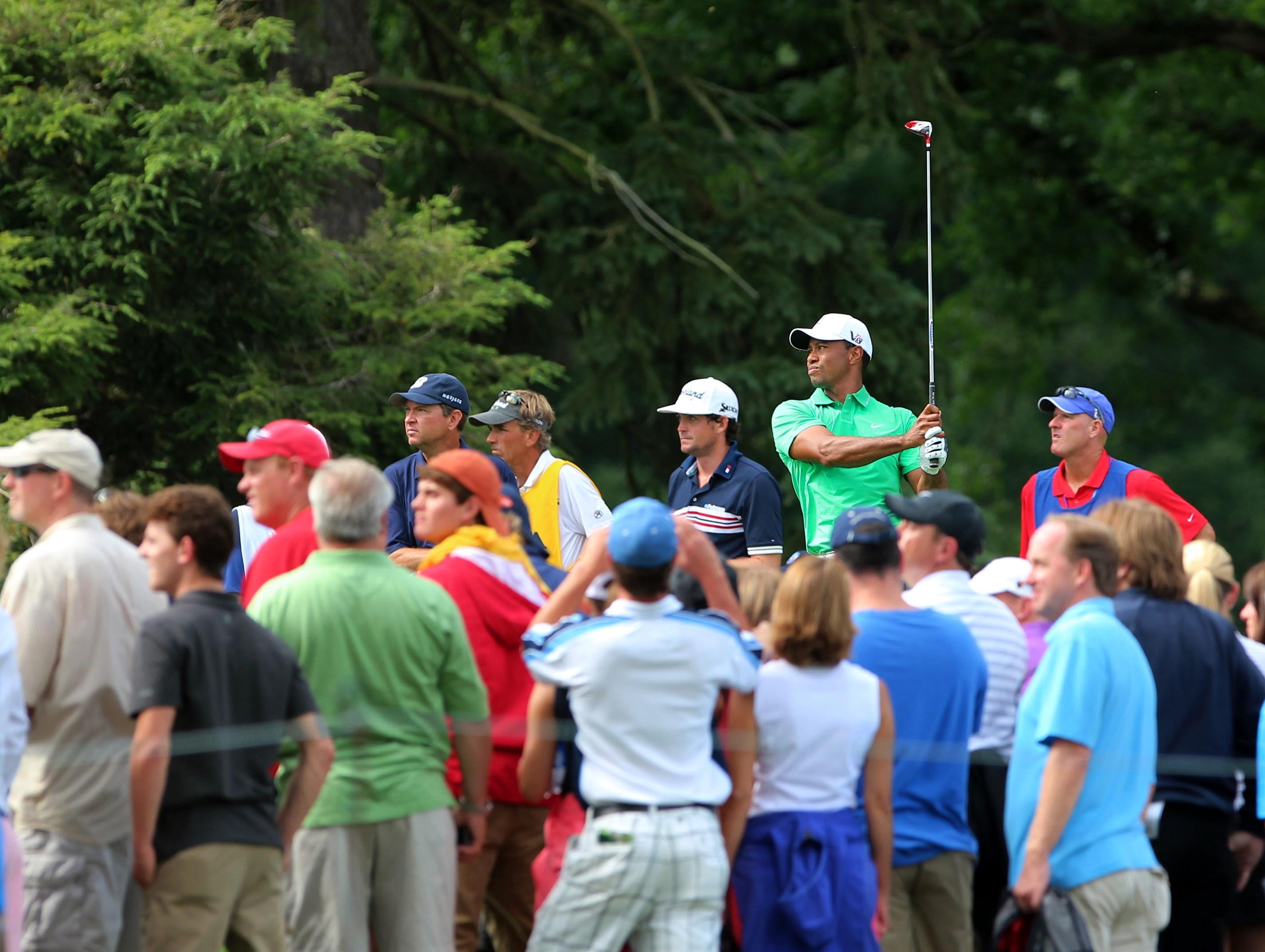 Tiger Woods tees off on the 9th hole.