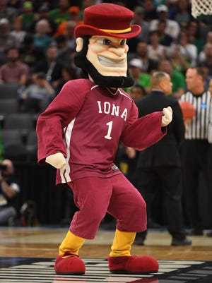 The Iona Gaels mascot - not to be confused with a creepier-looking version of Abraham Lincoln - dances on the court during a stoppage in play.