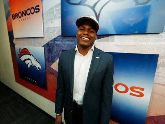 Denver Broncos wide receiver Carlos Henderson, who was one of the team's two third-round picks in the NFL Draft, jokes with photographers after being introduced to reporters at a news conference Saturday, April 29, 2017, at the team's headquarters in Englewood, Colo. (AP Photo/David Zalubowski)