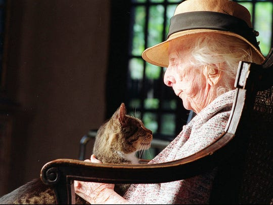 Marjory Stoneman Douglas is relaxes at her home with her cat, Willie, on March 5, 1994. Douglas, the feisty, tireless grande dame of the Florida Everglades who led the fight to preserve her ``river of grass,'' is the woman behind the five-day festival bearing her name, which begins Tuesday.