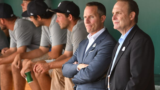 Chris Ilitch stands with Duane McLean, Tigers executive vice president of business operations, in the dugout before a special ceremony to honor Tigers owner Mike Ilitch before  Friday's game against the Orioles.