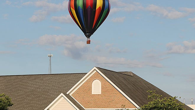 Just-A Dream balloon takes a flight over Ashland on Friday morning in the perfect sunny weather.
