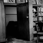 """File photo 1976 A hidden doorway in a wall of books at the Rundel Library once served as the entryway to the """"Secret Room."""""""