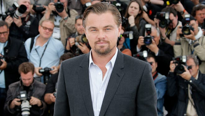 """Leonardo DiCaprio poses for photographers during a photo call for """"The Great Gatsby"""" at the 66th international film festival, in Cannes, southern France on May 15, 2013."""