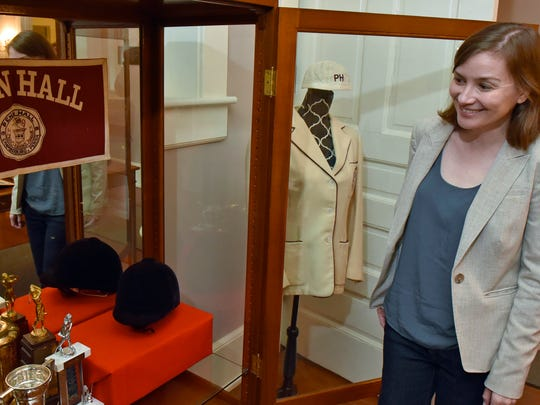 Amy Ensley, director of the Hankey Center at Wilson College, looks in on some of the items collected for a Penn Hall exhibit on Friday, October 21, 2016 in Chambersburg.