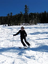 Skiing down Arizona Snowbowl.