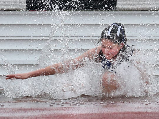 Annmarie Gruttadauro, Brockport, fights to keep her balance as she gets through the water hazard during the girls 2000 meter steeplechase.