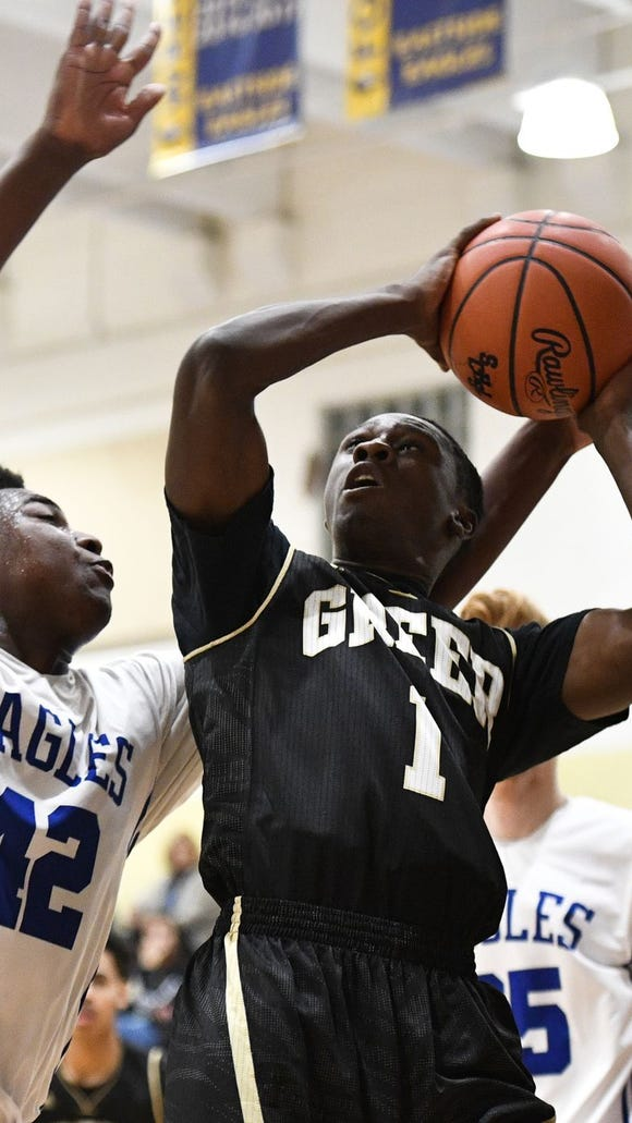 Greer's Darius Johnson (1) puts up a shot as Eastside's Dorian Miles (42) defends during the visiting Yellow Jackets' 65-46 victory Friday night.