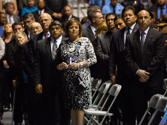 Hatch, NM Mayor Andy Nuñez, left,  U.S. Congressman Steve Pearce, NM Governor Susana Martinez's husband, Chuck Franco, Governor Martinez, Las Cruces, NM Mayor Ken Miyagishima and NM Attorney General Hector Balderas watch the casket of slain Hatch, NM police officer José Chavez being taken out of the Pan American Center in Las Cruces at the end of a memorial in his honor, Sunday, August 21, 2016.