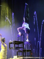 Gimmi Fornaciari balances on chairs while Dana Nadelcu watches Sunday during the Cirque Italia show in Anderson.